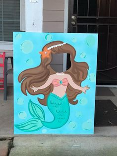 This mermaid photo prop has been hand painted onto sturdy foam board with acrylic paints, It stands at 40 inches tall and 32 inches wide. A stand is included. The outfit and hair color/skin color can be changed to suit your needs, just let me know! Also, please include your party date