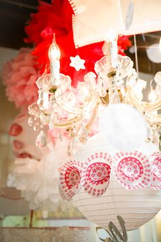 oh my!! see the cupcake liners on the paper ball over the chandelier!!