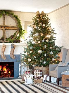 Love this Christmas tree from Cottage Living!  In order to complement the grass cloth wallpaper in this living room, a more organic approach was taken for the focal point. A woven basket serves as the tree's base, stockings are made from burlap, and an old, antique wheel covered in garland gives the mantel a country-Christmas vibe. (Photo: Monica Buck)