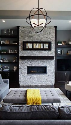 #homedesign #livingroomdecor #inspiration | Transitional formal living room in Cedar Rapids with gray walls, dark hardwood floors, a ribbon fireplace, a stone fireplace surround and a freestanding tv. — Houzz