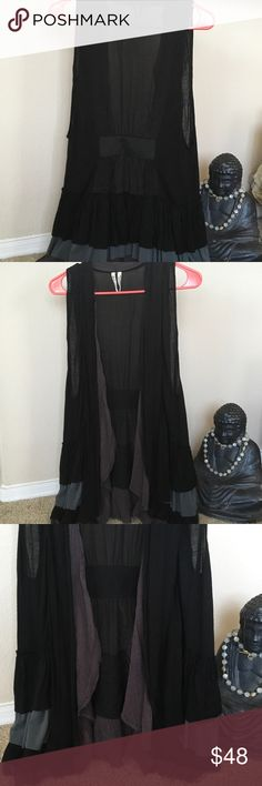 "FREE PEOPLE vest ruffles Viscose S/M Black Gray Sweet must have piece....... Black gray brown ruffles down back of vest... Goes over everything you own..S/M 29"" top of shoulder to front edge... 31"" top shoulder to back edge.💕⭐️😍🎁🎀🛍🛒 Free People Tops"