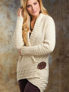 Free knittign pattern for Alabaster Cardigan - wrapped cardigan with cable border and shawl collar. Sizes XS, S, M, L, XL, 2X