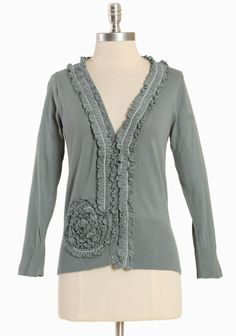 """Rose Ripple Cardi In Jade 49.99 at shopruche.com. This soft cotton cardigan is crafted in a muted jade green and accented with ruffle detailing, white stitching for contrast, and tonal button closures. Ribbed hemline and cuffs. , ,  100% Cotton ,  Imported,  22"""" length from top of shoulder"""