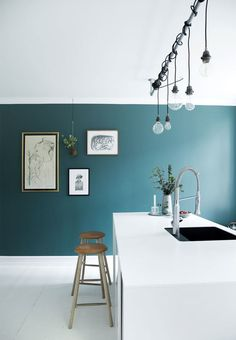 Loving the teal wall with the crisp white kitchen!