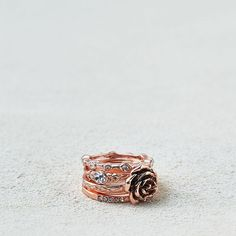 AE Rose & Stones Rings 5-Pack ($7.77) ❤ liked on Polyvore featuring jewelry, rings, metallic, pink ring, pink stone jewelry, pink jewelry, rose gold tone rings and pink stone rings