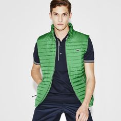 Lacoste - Golf Ripstop Vest --> Golf Ripstop Vest     BH1574-51      Made in a technical woven polyester known for durability, this versatile vest is ideal for layering over a polo on the golf course or on city streets.   Regular Fit