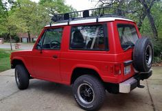 1989 Dodge Raider 4x4 V6 with Monstaliner body and custom bumper, wheels and roof rack.