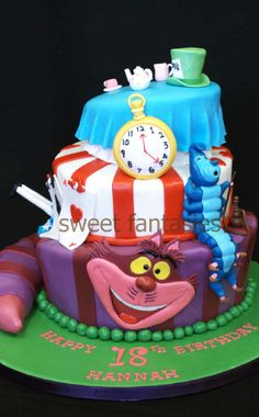 Alice in Wonderland cake that has cheshire cat, caterpillar, clock, the tea party(of course) and the queen of hearts card with her own layer!