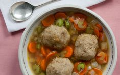 This take on a comforting classic puts savory roasted garlic into pillowy light matzoh balls and gives the broth a touch of warmth by infusing it with jalapeño. If you have leftover soup, store the matzoh balls and broth separately so the balls don't get soggy. Watch our how-to video.
