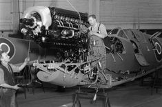 These technicians are fitting the Merlin engine at the Castle Bromwich Aircraft Factory. The engine - which produced - was able to power the Spitfire to - quicker than the Hurricane equipped with the same engine Aircraft Engine, Ww2 Aircraft, Fighter Aircraft, Military Aircraft, Spitfire Supermarine, Ww2 Spitfire, Lancaster, Douglas Bader, The Spitfires