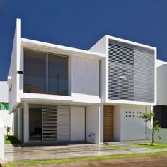 Front compact house Architectural Minimalism and Geometric Layouts with no garage
