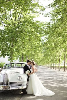 Gorgeous wedding photo by the car