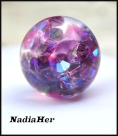 very pretty effect placing faceted beads inside resin sphere