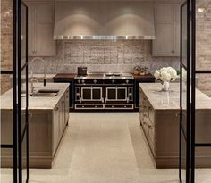 A chic entrance welcomes you to this sophisticated kitchen feat nuHaus's custom cabinetry & La Cornue #FrenchFridays