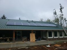 Solar photovoltaic panels for new home construction project in Comox, BC.