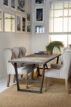 UNIQUE dining table with sophisticated chairs..edgy...& with art work....& greenery...interesting area of sensory pleasure....for dining...