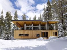 'The design of this new home in the old village at Sugarbowl is entirely a product of its dramatic environment. Perched on a concrete plinth that lifts the house above the tall winter snow-pa…