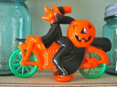 Vintage Halloween Witch on Motorcycle Orange and Black Pumpkin Jack O Lantern Candy Container Rosbro 1950's