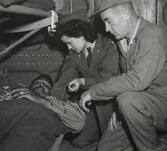 Lt. Pauline Curry & Tech. Sgt. Lewis Marker, 803rd MAETS, check a patient on a flight over India. On Nov. 7, 1943, the US 803rd Medical Air Evacuation Transport Squadron arrived at Chabua, India and flew first air evac mission. (Source: USAF)