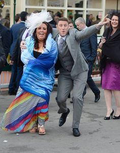 Racegoers react as they leave after the second day of the Grand National meeting at Aintree, northern England April 5, 2013. (Photo by Nigel Roddis/Reuters)
