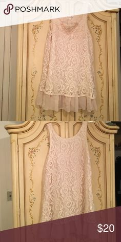 Creme lace sleeveless dress Really pretty lace dress. Can be dressed up or be sassy and wear it cowboy boots! Dresses