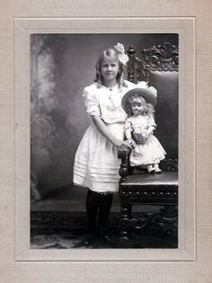 Google Image Result for http://www.antiquetoychest.com/wp-content/uploads/2011/08/Blonde-Victorian-Girl-with-her-Blonde-Doll.jpg
