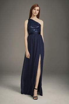 Subtly sophisticated, this White by Vera Wang bridesmaid dress features a one-shoulder sequin bodice with split satin straps, an illusion back, and a flowing crinkle chiffon skirt. White by Vera Wan Midnight Blue Bridesmaid Dresses, Vera Wang Bridesmaid Dresses, One Shoulder Bridesmaid Dresses, One Shoulder Gown, Blue Bridesmaids, Prom Dresses, Navy Sequin Dress, White By Vera Wang, Designer Wedding Dresses