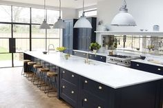 BECKI OWENS--Colors of the Modern Farmhouse + Paint Guide. Beautiful black Farmhouse kitchen.