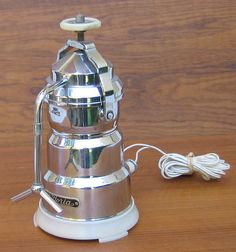 This is an exceptionally rare vintage minature espresso maker by Vittoria Italy. This 120 volt unit