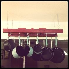 Pot rack made from old wooden ladder!