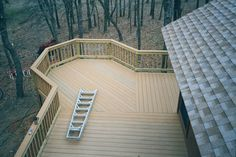 back deck idea- this would work off our bedroom but needs to come in by the house where the ladder is at to skirt the septic lid