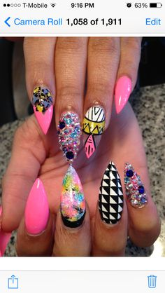Long stiletto nails with nailart checkerboard With a swarovski crystal nail