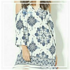 """Cold shoulder mini Coming soon! Gorgeous spaghetti strap cold shoulder mini in an vintage blue and white  print. Bust 39"""", length 32.35"""". Discounts given on bundles. Like to be notified of arrival boutique  Pants Jumpsuits & Rompers"""