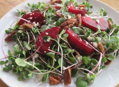Red plums & feta on microgreens
