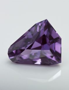 Prince Madagascar Sapphire in Natural Sunlight showing a shift towards blue. In candlelight this stone would go a bit more red.  A wonderful precision faceted purple sapphire.