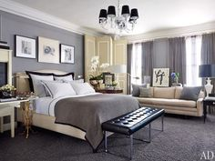 A chandelier by Williams-Sonoma Home overlooks a Kansas City, Missouri, master bedroom. The folding screen and sofa are vintage, the herringbone wool blanket is by Ralph Lauren Home, and the velvet curtains are by Restoration Hardware.Pin it.
