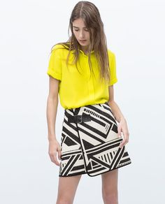 Image 1 of PIPED JACQUARD WITH FLARED SKIRT from Zara