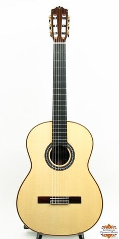 """The """"Luthier Series"""" guitars are COMPLETELY handmade by a small team of builders in a boutique workshop, using traditional spanish construction techniques.The C12 features a solid European Spruce top and solid Indian rosewood back and sides, a modern design with lattice bracing pattern and a RAISED ebony fretboard.  This is a BRAND NEW model from Cordoba and sounds phenomenal.  Scale length: 650mmnut width: 52mmIncludes a brown tolex covered hardshell Cordoba humidified archtop case."""