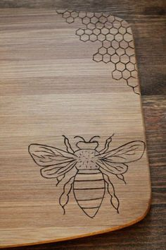 Woodburned bamboo cutting board , measuring 15 cm x 11 cm. Honey bee and honey comb design. Great for fall or a gift