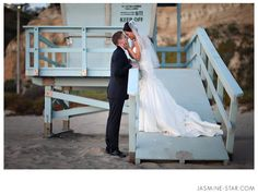 Bride and Groom on Malibu Lifeguard Tower - Beach Wedding Ceremony at The Sunset Restaurant - Malibu, California - Photography: www.Jasmine-Star.com