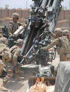 Soldiers from 3rd Platoon, Battery B, 4th Battalion, 320th Field Artillery Regiment, 4th Brigade Combat Team, 101 ABN DIV, 101st Airborne Division (Air Assault), load a 155mm High-Explosive round into a M777 howitzer during a fire mission in support of Easy Company, 2nd Battalion, 506th Infantry Regiment, out of Forward Operating Base Salerno, Afghanistan on June 11. U.S. Army photo by Spc. Robert Porter