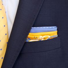 The Perfectionist - You can't go wrong with this Fourway Pocket Square. Be bold and classy with a yellow and blue floral design, or more subtle with plain quadrants and polka dots.