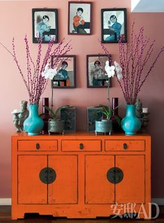 Don't like this specifically, but this idea of painting an entryway cabinet for some color I LOVE