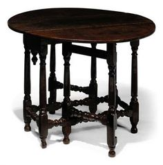 A QUEEN ANNE OAK GATELEG TABLE -   EARLY 18TH CENTURY, WELSH -  With original finial to the frieze at one end, the other frieze plain, on turned legs and original feet  28½ in. (72 cm.) high; 42 in. (107 cm.) extended; 37 in. (94 cm.) deep
