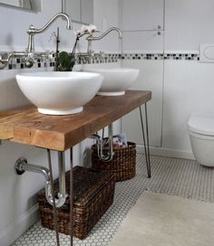 Bathroom vanities are so often incredibly boring—vast (or too-tiny) plastic surfaces that are hard to make work with other types of creative decor. But you