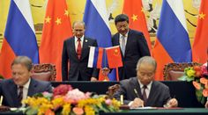 Energy goes east as Russia and China seal multibillion dollar deals in Beijing http://sumo.ly/88oI  Chinese President Xi Jinping (R, back) attends a signing ceremony with Russian President Vladimir Putin (L, back) at the Great Hall of the People in Beijing, China September 3, 2015. © Parker Song