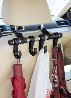 Things That Will Make Riding In Your Car So Much Better Stop your things from sliding around on your seats (or the floor) with this hanger system.Stop your things from sliding around on your seats (or the floor) with this hanger system. Diy Rangement, Car Office, Car Essentials, Mobile Office, Ideas Para Organizar, Car Accessories For Girls, Vehicle Accessories, Car Goals, Car Gadgets