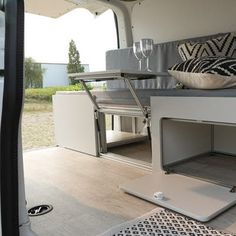 Bullifaktur's main sofa-bed unit includes storage in the frame and an available front panel that doubles. Ford Transit Connect Camper, Transit Camper, Build A Camper Van, Diy Camper, Van Conversion Interior, Camper Conversion, Van Bed, Sofa Bed Van, Camper Furniture