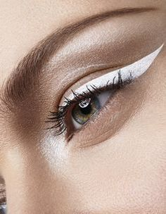 Make a statement with a swipe of white liquid liner. #eyeliner #makeup