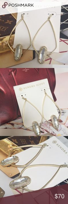 """Kendra Scott Arianna Drop Earrings An elegant pairing of classic style and minimalist shine, the open silhouette of Kendra Scott's Arianna Earrings combines subtle metallic detail with a small oval stone framed in pave. MATERIALS • 14K Gold Plated Over Brass • Size: 2.88""""L X 1.38""""W on earwire • Material: ivory mother-of-pearl Kendra Scott Jewelry Earrings"""